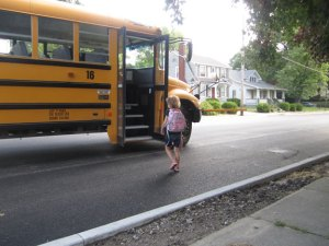 Ainsley walking towards the bus